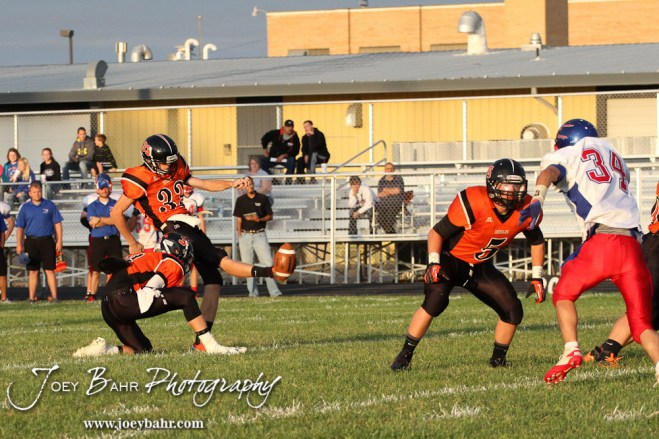 Larned Indian Michael Reece (#33) kicks a Point After Touchdown during the Ellinwood versus Larned High School football game with the Larned Indians winning 60 to 0 at Larned High School in Larned, Kansas on September 13, 2013. (Photo: Joey Bahr, www.joeybahr.com)