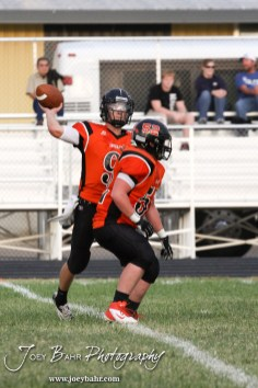 Larned Indian Easton Palmer (#9) throws a pass during the Ellinwood versus Larned High School football game with the Larned Indians winning 60 to 0 at Larned High School in Larned, Kansas on September 13, 2013. (Photo: Joey Bahr, www.joeybahr.com)