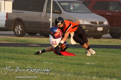 Ellinwood Eagle Tanner Swank (#22) intercepts the ball from Larned Indian Grant Unruh (#4) during the Ellinwood versus Larned High School football game with the Larned Indians winning 60 to 0 at Larned High School in Larned, Kansas on September 13, 2013. (Photo: Joey Bahr, www.joeybahr.com)