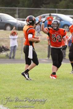 Larned Indian Easton Palmer (#9) celebrates a touchdown with Skyler Hoch (#52) during the Ellinwood versus Larned High School football game with the Larned Indians winning 60 to 0 at Larned High School in Larned, Kansas on September 13, 2013. (Photo: Joey Bahr, www.joeybahr.com)