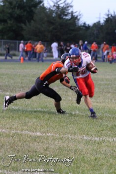 Larned Indian Evan Skelton (#1) tries to tackle Ellinwood Eagle Ryley Ney (#10) during the Ellinwood versus Larned High School football game with the Larned Indians winning 60 to 0 at Larned High School in Larned, Kansas on September 13, 2013. (Photo: Joey Bahr, www.joeybahr.com)
