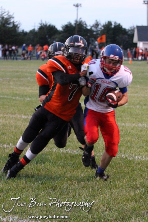 Larned Indian Jamil Shoemaker (#7) collides with Ellinwood Eagle Ryley Ney (#10) during the Ellinwood versus Larned High School football game with the Larned Indians winning 60 to 0 at Larned High School in Larned, Kansas on September 13, 2013. (Photo: Joey Bahr, www.joeybahr.com)