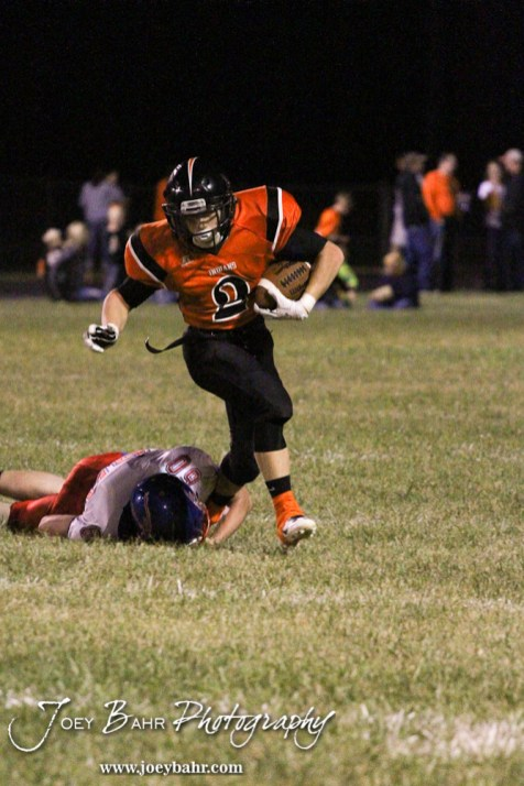 Ellinwood Eagle Adam Birzer (#60) tries to tackle Larned Indian Gage Stude (#2) during the Ellinwood versus Larned High School football game with the Larned Indians winning 60 to 0 at Larned High School in Larned, Kansas on September 13, 2013. (Photo: Joey Bahr, www.joeybahr.com)