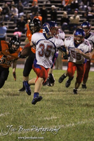 Ellinwood Eagle Gavin Vink (#35) runs with the ball during the Ellinwood versus Larned High School football game with the Larned Indians winning 60 to 0 at Larned High School in Larned, Kansas on September 13, 2013. (Photo: Joey Bahr, www.joeybahr.com)