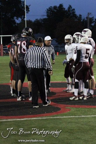 The Head Referee goes over the options after the coin toss before the Salina Central versus Great Bend High School Football game with Salina Central winning 41 to 14 at Memorial Field in Great Bend, Kansas on October 25, 2013. (Photo: Joey Bahr, www.joeybahr.com)