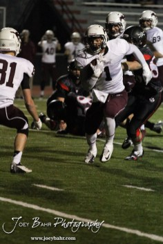 Salina Central Mustang Malik Veal (#1) rushes through an opening in the Great Bend Panther line during the Salina Central versus Great Bend High School Football game with Salina Central winning 41 to 14 at Memorial Field in Great Bend, Kansas on October 25, 2013. (Photo: Joey Bahr, www.joeybahr.com)