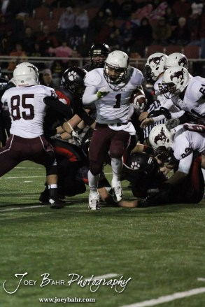 Salina Central Mustang Malik Veal (#1) busts through a hole during the Salina Central versus Great Bend High School Football game with Salina Central winning 41 to 14 at Memorial Field in Great Bend, Kansas on October 25, 2013. (Photo: Joey Bahr, www.joeybahr.com)