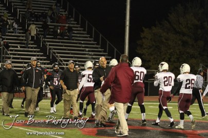 Great Bend Panther Head Coach Bo Black shakes hands Salina Central Mustang Head Coach Michael Hall during the Salina Central versus Great Bend High School Football game with Salina Central winning 41 to 14 at Memorial Field in Great Bend, Kansas on October 25, 2013. (Photo: Joey Bahr, www.joeybahr.com)