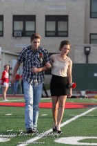 Candidates Hannah Wilborn and Cody Phelps take their place during the 2013 Hoisington High School Homecoming Festivities prior to the Larned at Hoisington Football game at Elton Brown Field in Hoisington, Kansas on October 11, 2013. (Photo: Joey Bahr, www.joeybahr.com)