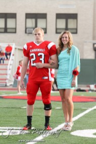 Candidates Jordin Greer and Avery Urban pause for a picture during the 2013 Hoisington High School Homecoming Festivities prior to the Larned at Hoisington Football game at Elton Brown Field in Hoisington, Kansas on October 11, 2013. (Photo: Joey Bahr, www.joeybahr.com)