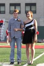 Candidates Ashley Lockwood and Lucas Flagor pause for pictures during the 2013 Hoisington High School Homecoming Festivities prior to the Larned at Hoisington Football game at Elton Brown Field in Hoisington, Kansas on October 11, 2013. (Photo: Joey Bahr, www.joeybahr.com)