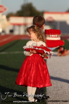 The Attendants wait for the announcement of the King and Queen during the 2013 Hoisington High School Homecoming Festivities prior to the Larned at Hoisington Football game at Elton Brown Field in Hoisington, Kansas on October 11, 2013. (Photo: Joey Bahr, www.joeybahr.com)