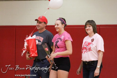 Hoisington Lady Cardinal Ashley Lockwood (#13) and her parents are recognized during Parent's Night ceremony before the Hoisington versus Smoky Valley volleyball match with Hoisington winning in two sets at Hoisington Activity Center in Hoisington, Kansas on October 22, 2013. (Photo: Joey Bahr, www.joeybahr.com)