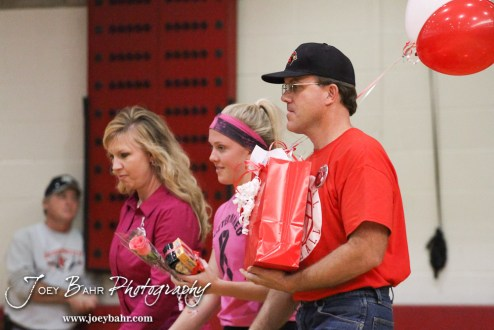 Hoisington Lady Cardinal Abi Rziha (#21) and her parents are recognized during Parent's Night ceremony before the Hoisington versus Smoky Valley volleyball match with Hoisington winning in two sets at Hoisington Activity Center in Hoisington, Kansas on October 22, 2013. (Photo: Joey Bahr, www.joeybahr.com)