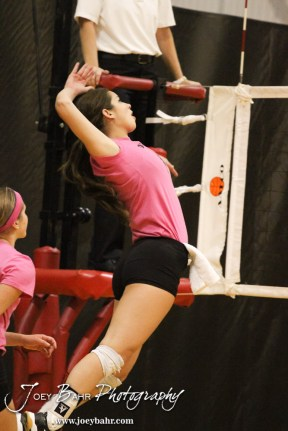 Hoisington Lady Cardinal Jordan Moore (#7) goes for a kill during the Hoisington versus Smoky Valley volleyball match with Hoisington winning in two sets at Hoisington Activity Center in Hoisington, Kansas on October 22, 2013. (Photo: Joey Bahr, www.joeybahr.com)