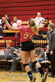 Hoisington Lady Cardinal Abi Rziha (#21) serves during the Hoisington versus Smoky Valley volleyball match with Hoisington winning in two sets at Hoisington Activity Center in Hoisington, Kansas on October 22, 2013. (Photo: Joey Bahr, www.joeybahr.com)