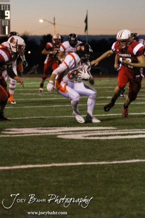 Larned Indian Isiah Perez (#84) cuts to avoid a tackle during the Larned at Hoisington High School Football game with Hoisington winning 27 to 9 at Elton Brown Field in Hoisington, Kansas on October 11, 2013. (Photo: Joey Bahr, www.joeybahr.com)