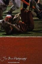 Hoisington Cardinal Taylor Richter (#7) lies close to the end zone during the Larned at Hoisington High School Football game with Hoisington winning 27 to 9 at Elton Brown Field in Hoisington, Kansas on October 11, 2013. (Photo: Joey Bahr, www.joeybahr.com)