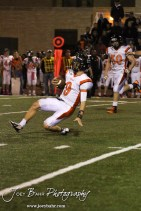 Larned Indian Easton Palmer (#9) slides while running with the ball during the Larned at Hoisington High School Football game with Hoisington winning 27 to 9 at Elton Brown Field in Hoisington, Kansas on October 11, 2013. (Photo: Joey Bahr, www.joeybahr.com)