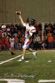 Larned Indian Easton Palmer (#9) throws a pass during the Larned at Hoisington High School Football game with Hoisington winning 27 to 9 at Elton Brown Field in Hoisington, Kansas on October 11, 2013. (Photo: Joey Bahr, www.joeybahr.com)