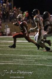 Hoisington Cardinal Nolan McCurry (#22) rushes with the ball during the Larned at Hoisington High School Football game with Hoisington winning 27 to 9 at Elton Brown Field in Hoisington, Kansas on October 11, 2013. (Photo: Joey Bahr, www.joeybahr.com)