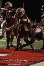Hoisington Cardinal Avery Urban (#23) scores a touchdown during the Larned at Hoisington High School Football game with Hoisington winning 27 to 9 at Elton Brown Field in Hoisington, Kansas on October 11, 2013. (Photo: Joey Bahr, www.joeybahr.com)