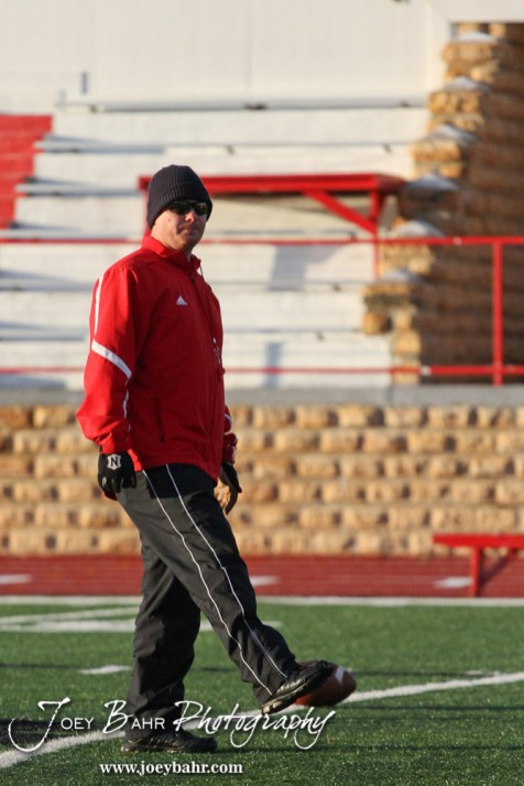 Hoisington Cardinal Head Coach Jason Ingram leads warmup exercises before the KSHSAA Class 4A District 15 Football game between Scott City and Hoisington with Scott City winning 14 to 0 at Elton Brown Field in Hoisington, Kansas on October 18, 2013. (Photo: Joey Bahr, www.joeybahr.com)