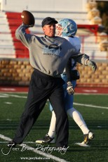 Scott City Beaver Head Coach Glenn O'Neil throws a pass during warmups for the KSHSAA Class 4A District 15 Football game between Scott City and Hoisington with Scott City winning 14 to 0 at Elton Brown Field in Hoisington, Kansas on October 18, 2013. (Photo: Joey Bahr, www.joeybahr.com)