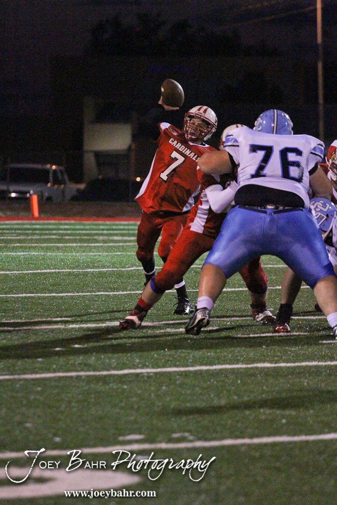 Hoisington Cardinal Taylor Richter (#7) throws a pass during the KSHSAA Class 4A District 15 Football game between Scott City and Hoisington with Scott City winning 14 to 0 at Elton Brown Field in Hoisington, Kansas on October 18, 2013. (Photo: Joey Bahr, www.joeybahr.com)