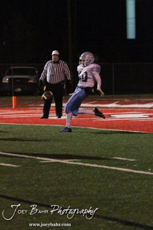 Scott City Beaver Marshall Hutchins (#40) punts the ball during the KSHSAA Class 4A District 15 Football game between Scott City and Hoisington with Scott City winning 14 to 0 at Elton Brown Field in Hoisington, Kansas on October 18, 2013. (Photo: Joey Bahr, www.joeybahr.com)