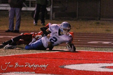 Scott City Beaver Brayden Strine (#2) stretches out to score a touchdown during the KSHSAA Class 4A District 15 Football game between Scott City and Hoisington with Scott City winning 14 to 0 at Elton Brown Field in Hoisington, Kansas on October 18, 2013. (Photo: Joey Bahr, www.joeybahr.com)