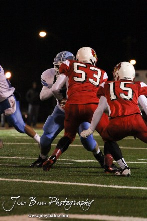 Hoisington Cardinal Chris Wright (#53) blocks a Scott City Beaver during the KSHSAA Class 4A District 15 Football game between Scott City and Hoisington with Scott City winning 14 to 0 at Elton Brown Field in Hoisington, Kansas on October 18, 2013. (Photo: Joey Bahr, www.joeybahr.com)