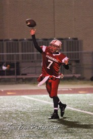 Hoisington Cardinal Taylor Richter (#7) throws a pass during the KSHSAA Class 4A District 15 Football game between Scott City and Hoisington with Scott City winning 14 to 0 at Elton Brown Field in Hoisington, Kansas on October 18, 2013. (Photo: Joey Bahr, www.joeybahr.com)