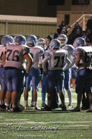 Scott City Beaver Head Coach Glenn O'Neil talks to his team during a timeout during the KSHSAA Class 4A District 15 Football game between Scott City and Hoisington with Scott City winning 14 to 0 at Elton Brown Field in Hoisington, Kansas on October 18, 2013. (Photo: Joey Bahr, www.joeybahr.com)