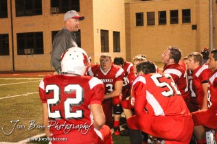 The Hoisington Cardinals listen to Head Coach Jason Ingram after the KSHSAA Class 4A District 15 Football game between Scott City and Hoisington with Scott City winning 14 to 0 at Elton Brown Field in Hoisington, Kansas on October 18, 2013. (Photo: Joey Bahr, www.joeybahr.com)