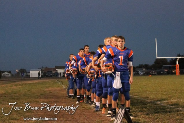 The Otis-Bison Cougars line up for the National Anthem before the Sylvan-Lucas vs Otis-Bison High School football game with Otis-Bison winning 32 to 30 at Otis-Bison High School Field in Otis, Kansas on October 31, 2013. (Photo: Joey Bahr, www.joeybahr.com)