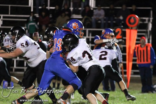 Two Sylvan-Lucas Mustangs try to block Otis-Bison Cougar Jordan Hoffman (#33) during the Sylvan-Lucas vs Otis-Bison High School football game with Otis-Bison winning 32 to 30 at Otis-Bison High School Field in Otis, Kansas on October 31, 2013. (Photo: Joey Bahr, www.joeybahr.com)