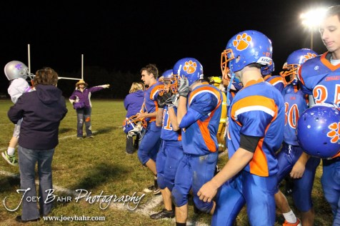 The Otis-Bison Cougars line up to leave the field following the Sylvan-Lucas vs Otis-Bison High School football game with Otis-Bison winning 32 to 30 at Otis-Bison High School Field in Otis, Kansas on October 31, 2013. (Photo: Joey Bahr, www.joeybahr.com)