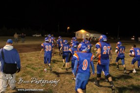 The Otis-Bison Cougars run off the field after the Sylvan-Lucas vs Otis-Bison High School football game with Otis-Bison winning 32 to 30 at Otis-Bison High School Field in Otis, Kansas on October 31, 2013. (Photo: Joey Bahr, www.joeybahr.com)