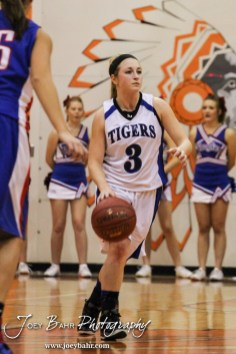 St. John Lady Tiger Tia Smith (#3) dribbles the ball down the court during the Opening Round of the Seventh Annual Keady Basketball Classic matchup between the Ellinwood Lady Eagles and the St. John Lady Tigers with Ellinwood winning 40 to 38 in overtime at Larned Middle School in Larned, Kansas on December 9, 2013. (Photo: Joey Bahr, www.joeybahr.com)