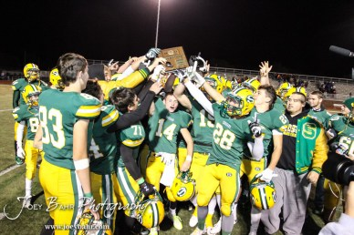 The Salina South Cougars hold up the District Champions trophy following the Great Bend versus Salina South High School football game with Salina South winning 56 to 13 at Salina Stadium in Salina, Kansas on November 1, 2013. (Photo: Joey Bahr, www.joeybahr.com)