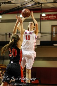 Russell Lady Bronco Kyleigh Kasper (#40) goes up for a shot over Ellsworth Lady Bearcat Connor Davis (#20) during the 2014 Hoisington Cardinal Winter Jam First Round basketball game with the Russell Lady Broncos versus the Ellsworth Lady Bearcats with Russell winning 54 to 52 in Hoisington Activity Center in Hoisington, Kansas on January 20, 2014. (Photo: Joey Bahr, www.joeybahr.com)