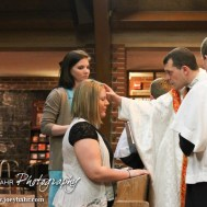 during the Easter Vigil Mass at St. Patrick's Catholic Church in McCook, Nebraska on April 19, 2014. (Photo: Joey Bahr, www.joeybahr.com)