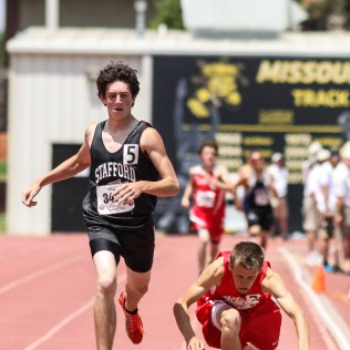 Macksville's Henry Penner dives at the finish line as Stafford's Derek McClure wins the 1A Boys 1600 Meter Run during the Second Day of the 2014 KSHSAA State Track Meet at Cessna Stadium on the campus of Wichita State University in Wichita, Kansas on May 31, 2014. (Photo: Joey Bahr, www.joeybahr.com)