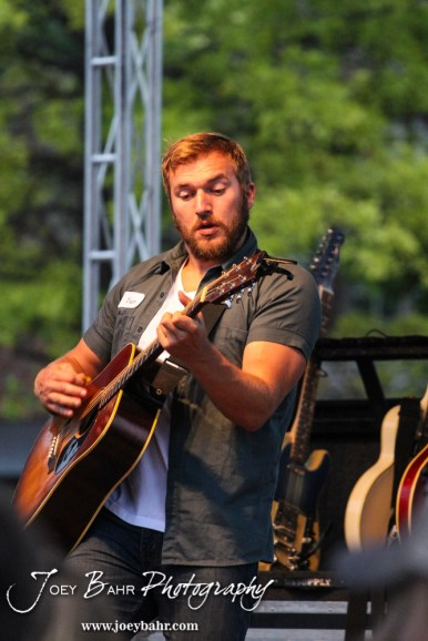 Logan Mize performs durning the Ellinwood After Harvest Festival at City Park in Ellinwood, Kansas on July 17, 2014. (Photo: Joey Bahr, www.joeybahr.com)