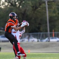 Larned Indian Isiah Perez (#84) jumps for a ball as Kingman Eagle Cody New (#2) defends during the Kingman Eagles versus Larned Indians High School Football Game with Kingman winning 3 to 0 at Earl Roberts Field at Larned High School near Larned, Kansas on September 19, 2014. (Photo: Joey Bahr, www.joeybahr.com)