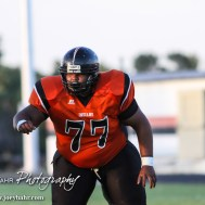 Larned Indian Marcus Allen (#77) moves to block a Kingman Eagle during the Kingman Eagles versus Larned Indians High School Football Game with Kingman winning 3 to 0 at Earl Roberts Field at Larned High School near Larned, Kansas on September 19, 2014. (Photo: Joey Bahr, www.joeybahr.com)
