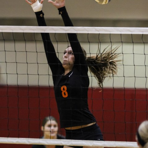 Larned Lady Indian Jessica Gobin (#8) tries to block the ball during the Kingman Lady Eagles versus Larned Lady Indians volleyball match with Kingman winning 25-21, 24-26, 25-15 at Hoisington Activity Center in Hoisington, Kansas on September 9, 2014. (Photo: Joey Bahr, www.joeybahr.com)