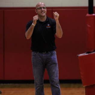 Larned Lady Indian Head Coach Paul Deveaux celebrates winning a point during the Kingman Lady Eagles versus Larned Lady Indians volleyball match with Kingman winning 25-21, 24-26, 25-15 at Hoisington Activity Center in Hoisington, Kansas on September 9, 2014. (Photo: Joey Bahr, www.joeybahr.com)