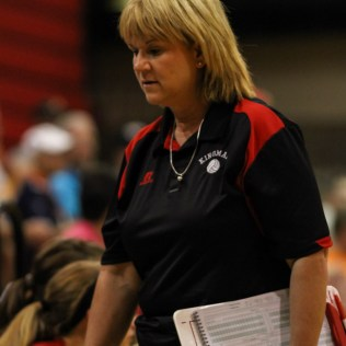 Kingman Lady Eagle Head Coach Kay Stimatze walks to the bench after discussing a call with the referees during the Kingman Lady Eagles versus Larned Lady Indians volleyball match with Kingman winning 25-21, 24-26, 25-15 at Hoisington Activity Center in Hoisington, Kansas on September 9, 2014. (Photo: Joey Bahr, www.joeybahr.com)